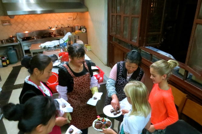 After the celebration, the girls share our leftover cake with the Kitchen ladies who helped make it all happen