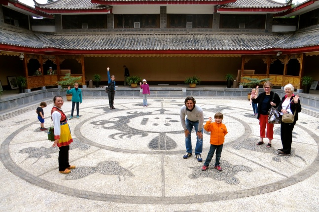 At the museum, the courtyard's stone work displayed the Chinese zodiac calendar.  We each found our animal and smiled for the camera.
