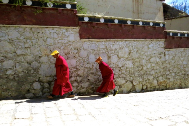Monks on their way to the stupa for prayer