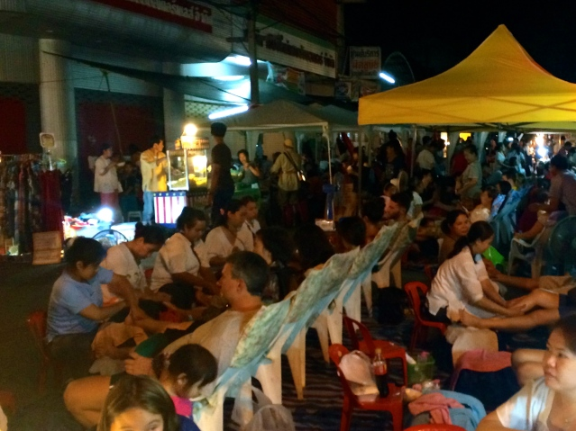 These are Thai massage chairs, lining the open streets for anyone to enjoy a quick foot rub