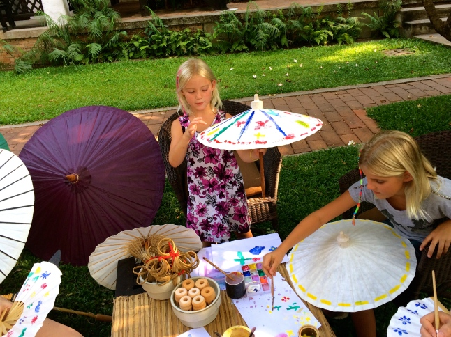 Thayer and Zoe do some Thai umbrella painting