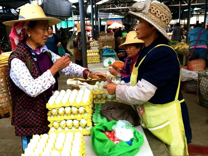 Ladies haggle for fresh eggs