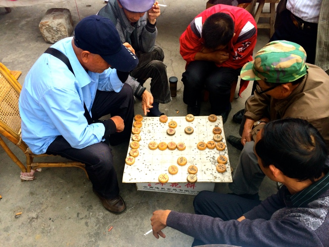 Locals play the Chinese game of Mah Jong