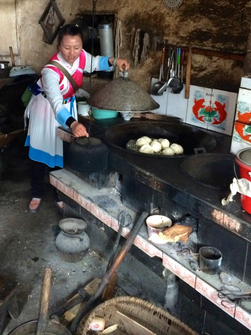 She was cooking steamed buns on her stove top
