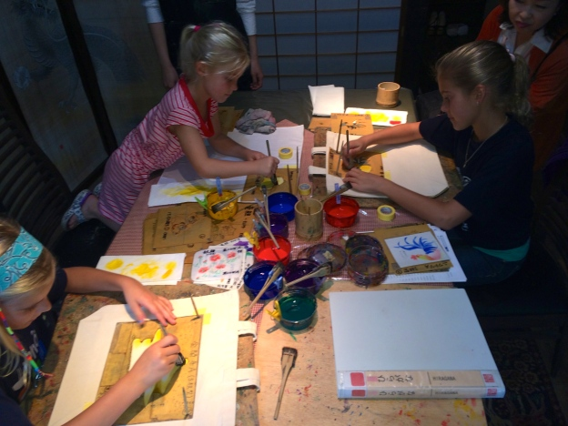 The girls shared a table and paints, and got right to work